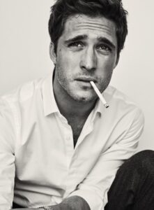 Actor Diego Boneta holds a cigarette between his soft lips