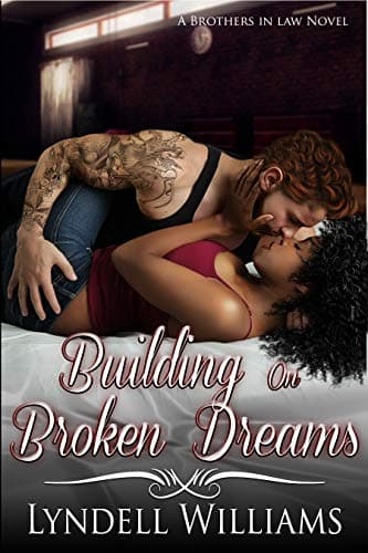 A white man kisses a Black woman on the cover of Building on Broken Dreams by Lyndell Williams